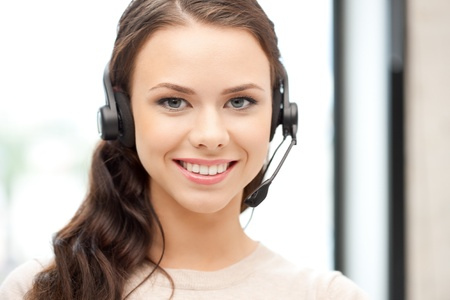 telephone headsets: bright picture of friendly female helpline operator