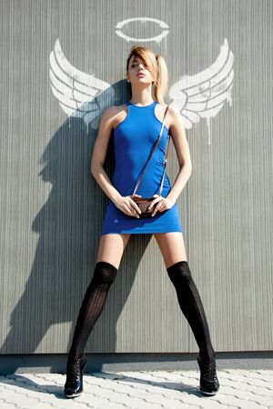 angel alone: picture of fashionable girl in bue dress with angel wings