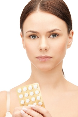 picture of young beautiful woman with pills photo