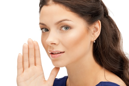 bright picture of young woman whispering gossip Stock Photo - 10597197