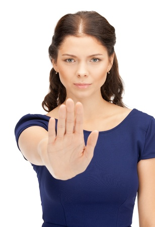 bright picture of young woman making stop gesture photo