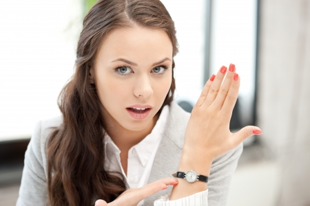 bright picture of attractive businesswoman with watch photo