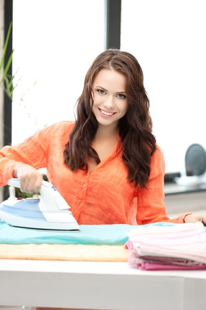bright picture of lovely housewife with iron Stock Photo - 10597175