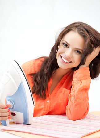 bright picture of lovely housewife with iron photo
