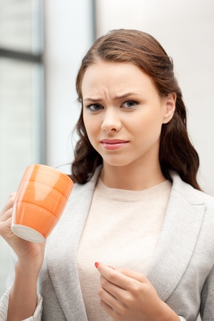 disgusting: bright picture of lovely businesswoman with mug
