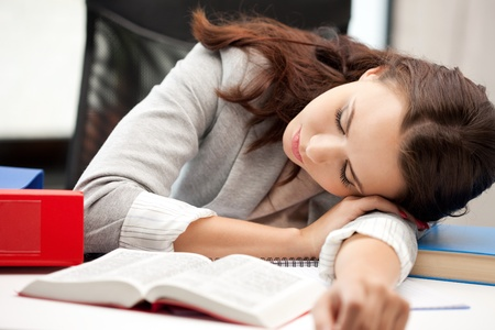 bright picture of sleeping woman with book photo