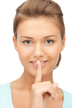 shh: bright picture of young woman with finger on lips