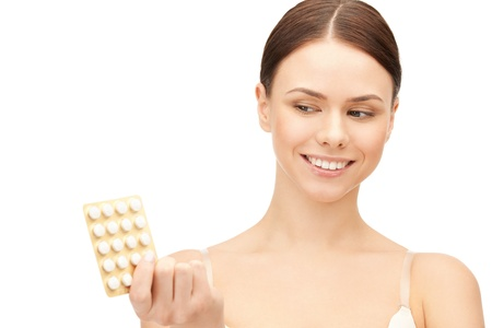 contraception: picture of young beautiful woman with pills