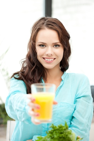 .picture of beautiful woman with glass of juice. . photo