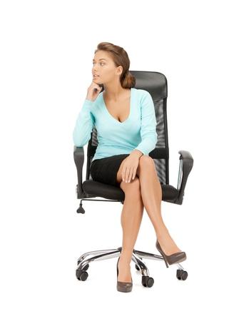 mujer sentada: imagen de la joven empresaria sentado en silla Foto de archivo