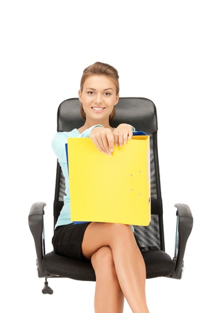 picture of young businesswoman with folders sitting in chair Stock Photo - 10703731