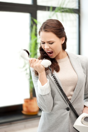 bright picture of angry businesswoman with phone Stock Photo - 10703779