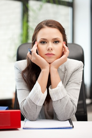 picture of calm woman with big notepad photo
