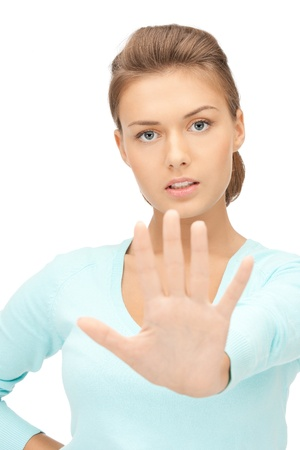 interdiction: bright picture of young woman making stop gesture Stock Photo
