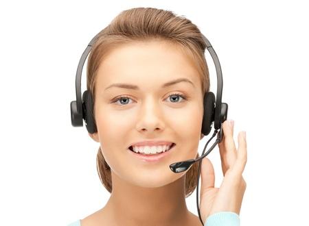 telephone headsets: imagen brillante de operador amistoso helpline hembra Foto de archivo