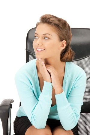 picture of young businesswoman sitting in chair photo