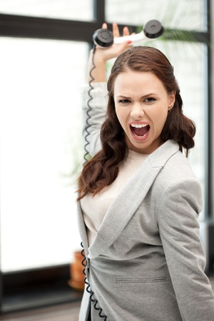 bright picture of angry businesswoman with phone photo