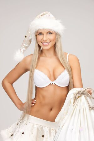 picture of cheerful santa helper girl with big bag photo
