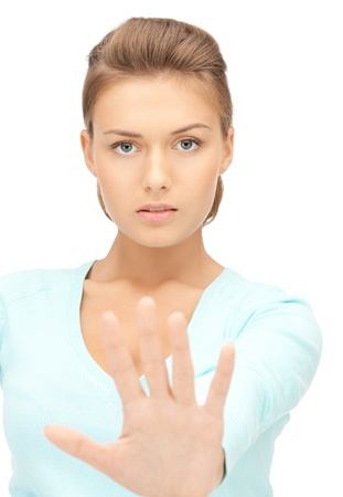 hand stop: bright picture of young woman making stop gesture Stock Photo