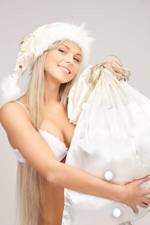 tempting: picture of cheerful santa helper girl with big bag