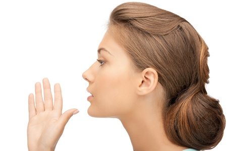 bright picture of young woman whispering gossip photo