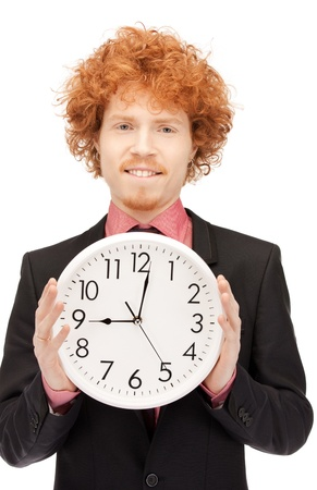 bright picture of handsome man with clock Stock Photo - 10823374