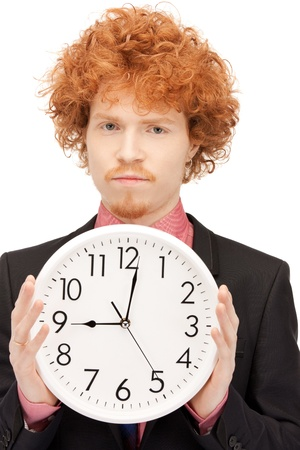 bright picture of handsome man with clock Stock Photo - 10872504
