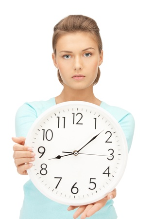 bright picture of woman holding big clock Stock Photo - 10897485