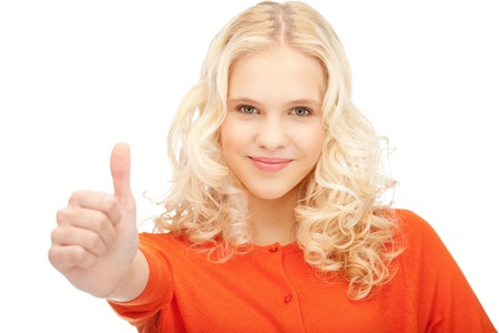 bright picture of lovely teenage girl with thumbs up Stock Photo - 10930546