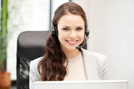 telephone headsets: picture of helpline operator with laptop computer