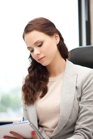 picture of calm woman with big notepad Stock Photo - 10930549