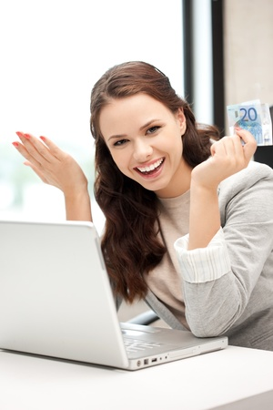 woman holding money: picture of happy woman with laptop computer and euro cash money Stock Photo