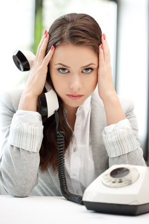 bad news: bright picture of sad businesswoman with phone