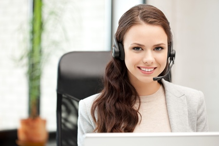 secretary woman: picture of helpline operator with laptop computer
