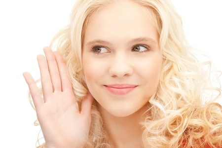 bright picture of young woman listening gossip Stock Photo - 11022980
