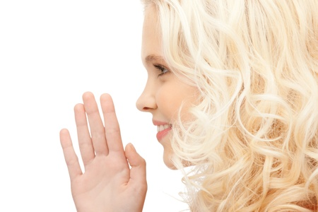 bright picture of young woman whispering gossip Stock Photo - 11022832