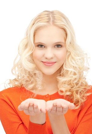 beautiful woman showing something on the palm of her hand Stock Photo - 11022989