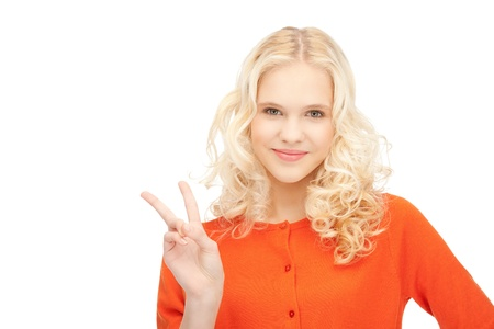 bright picture of lovely teenage girl showing victory sign Stock Photo - 11022836