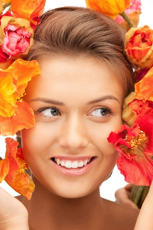 picture of lovely woman with red flowers Stock Photo - 11022971