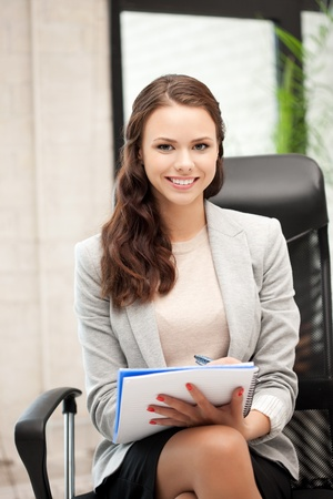 gorgeous businesswoman: picture of happy woman with big notepad