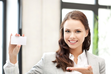 bright picture of confident woman with business card Stock Photo - 11023227