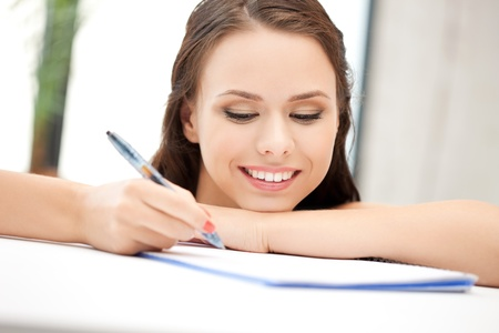 picture of happy woman with big notepad photo