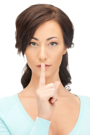 bright picture of young woman with finger on lips Stock Photo - 11094386