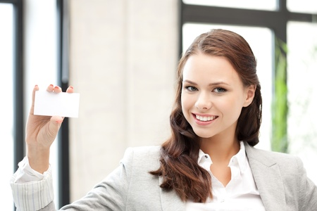 bright picture of confident woman with business card Stock Photo - 11133622