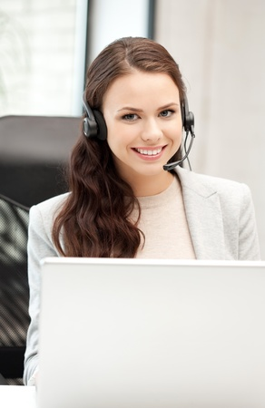 picture of helpline operator with laptop computer photo