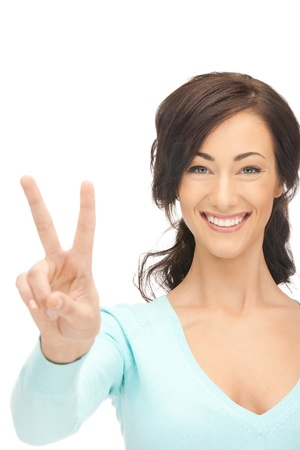 bright picture of lovely teenage girl showing victory sign Stock Photo - 11133657