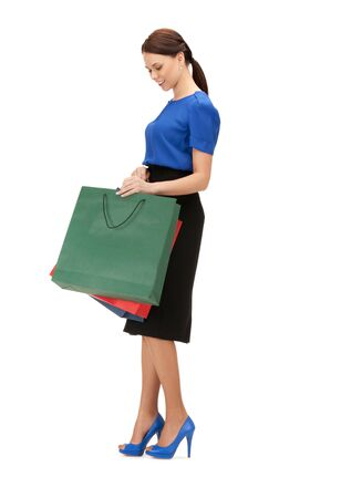consumerism: picture of lovely woman with shopping bags