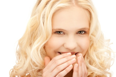tattle: bright closeup picture of beautiful laughing woman Stock Photo