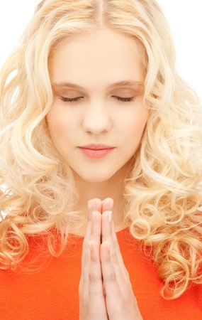 bright closeup portrait picture of praying businesswoman photo