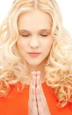 bright closeup portrait picture of praying businesswoman Stock Photo - 11188847
